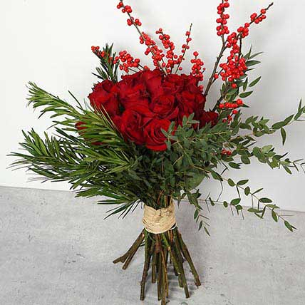 Red Roses and Ilex Berries Bouquet BH: Flower Delivery Bahrain