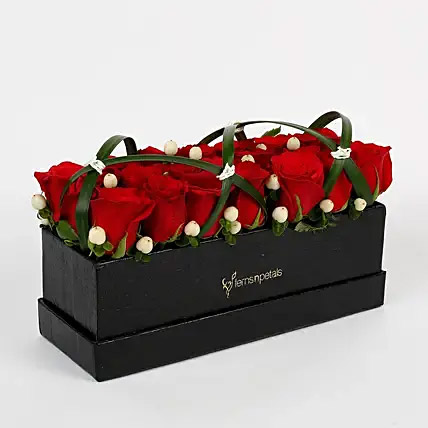 21 Premium Enticing Red Roses in Black FNP Box: Send Gifts To India