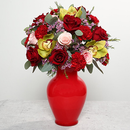 Mixed Flowers In Red Glass Vase: New Year Flowers