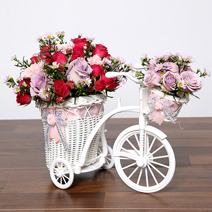 Purple and Pink Flowers In Cycle Basket: One Hour Delivery Gifts