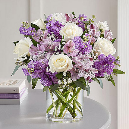 Purple and White Floral Bunch In Glass Vase: Flower Delivery Al Ain