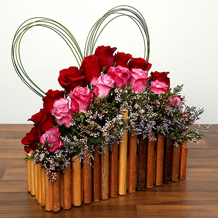 Red and Purple Roses In A Wooden Base: Valentines Day Flower Arrangements