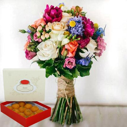 Mesmerizing Flowers and Motichoor Laddoo Combo: Bhai Dooj Sweets