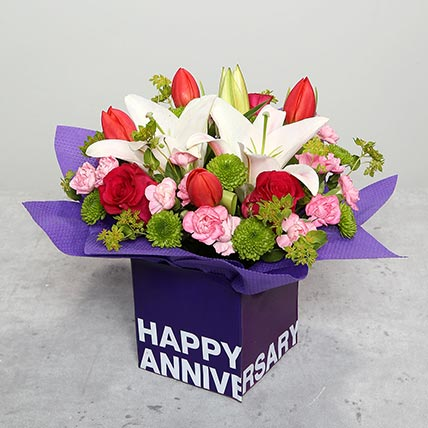 Tulips Roses and Carnations in Glass Vase: Anniversary Flowers