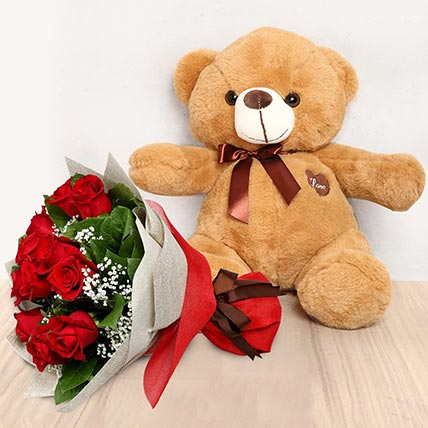 12 Red Roses Bouquet with Brown Teddy: Valentine Gift Hampers to Umm Al Quwain