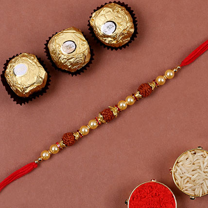Golden Red Rudraksh Rakhi And 3 Pcs Ferrero Rocher: Rudraksha Rakhi